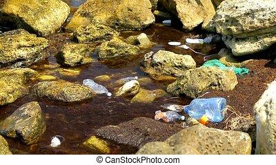 global ocean pollution, garbage floating in sea water, close-up