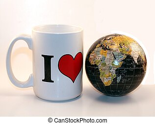 A world globe with I Love Mug and market economy against a white background. Business, financial and world trade. Global trade, financing and business.