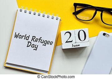 World Refugee Day 20 twentieth june Month Calendar Concept on Wooden Blocks.
