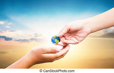 World Tourism Day concept: hand holding earth globe give others over natural background