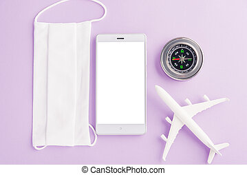 model plane, compass, face mask protective and mobile smartphone blank screen