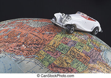 World Travel - A toy car on a globe - world travel concept.