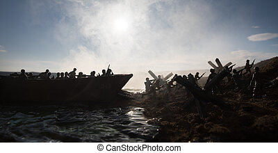 World War 2 reenactment (D-day). Creative decoration with toy soldiers, landing crafts and hedgehogs. Battle scene of Normandy landing on June 6, 1944.