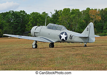 World War Two aircraft parked on grassy air field