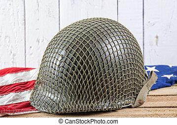 military helmet on an American Flag