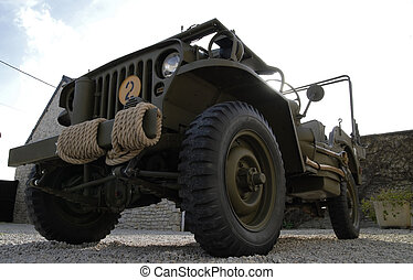 world war two military vehicle with a rope on the bumper