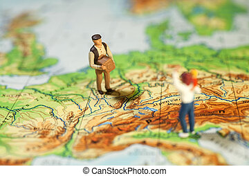 Worldwide Courier Service. A tiny miniature figurine of a ...