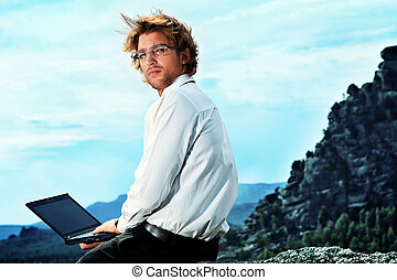 worldwide - Successful business man working on a laptop on a...