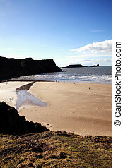 Worm's Head as seen from Rhossili Bay on the Gower Peninsular West Glamorgan Wales UK