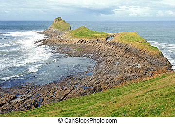 Wiew of Worms Head in Gower, Wales, coastline on a sunny day