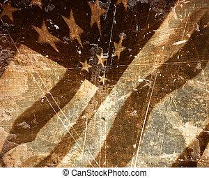 worn american flag waving in the wind