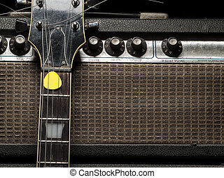 worn electric guitar and amplifier, for music and entertainment themes