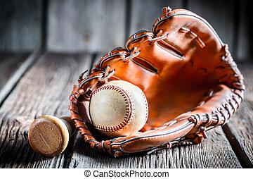 Worn Baseball ball and glove