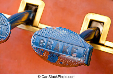 worn brake pedal on a vintage automobile