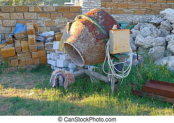 concrete mixer - Worn concrete mixer on working site