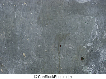 worn gray blue metal plate with 1 rusty bolt