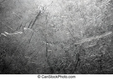 Industrial background from worn brushed metal sheet