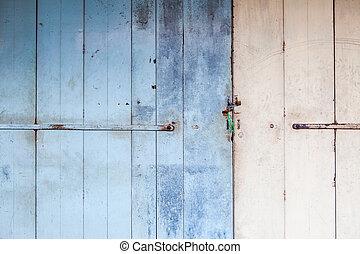 Worn old wooden door locked