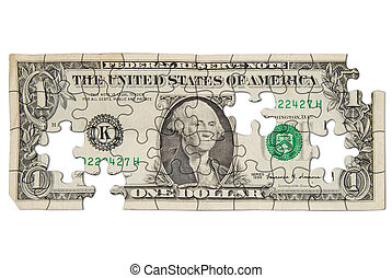 Worn one dollar bill cut out into puzzle shapes isolated over white