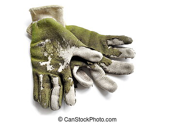 old worn out green garden hand gloves