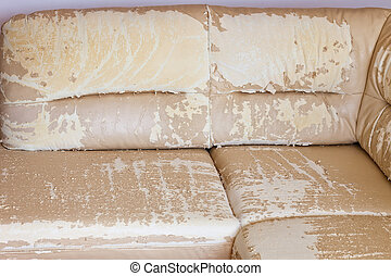 Worn synthetic leather - Beige damaged or cracked synthetic...
