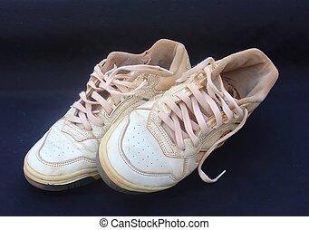 worn tennis - Pair of worn tennis