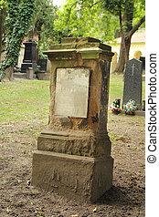 worn tombstone