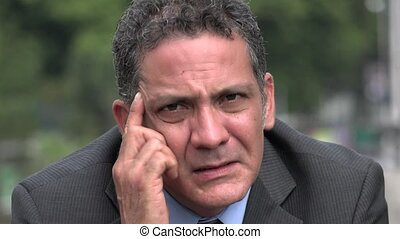 Worried Adult Hispanic Businessman