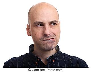Worried bald man looking away. Isolated