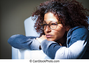Worried black woman at home alone