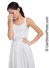 Worried brunette posing
