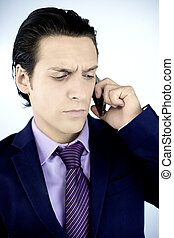 Worried business man on the phone