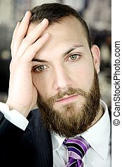 Worried business man thinking closeup
