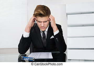 Worried Businessman Reading Document