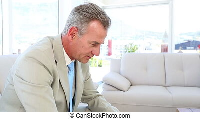 Worried businessman sitting on couc