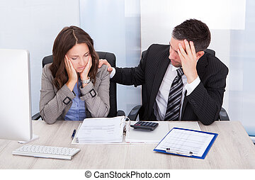Worried Businesspeople Calculating Finance - Worried...