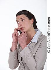 Worried businesswoman on a cellphone