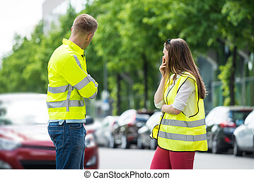 Worried Couple Looking At Broken Car