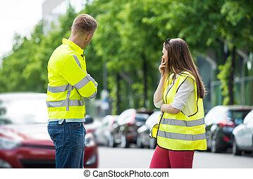 Worried Couple Looking At Broken Car