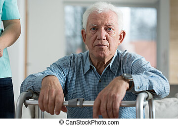 Horizontal view of worried disabled senior man