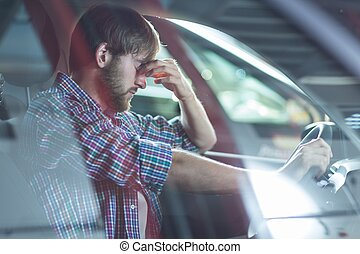 Worried driver in his car - Image of worried driver sitting...