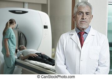 Worried expert senior male doctor awaiting his patient to underg
