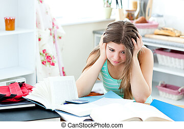 worried girl doing her homework