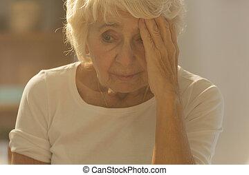 Worried ill senior woman