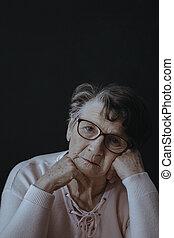 Worried lonely elderly woman