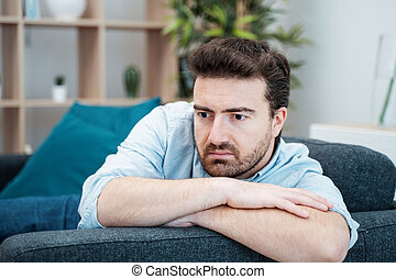 Worried man feeling bad at home