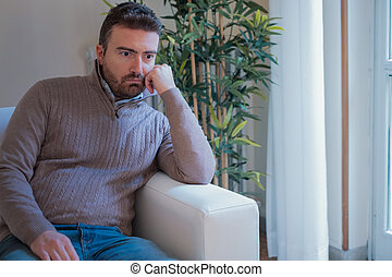 Worried man feeling negative emotions at home