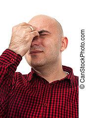 Worried man having headache