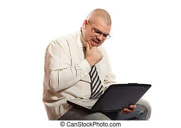 worried man looking at computer