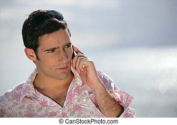 Worried man talking on the phone